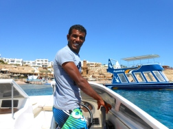 Our speedboat driver, he took us from the hotel jetty to the boat for the tour.